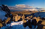 Shadows over rocks in snowy landscape