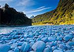 Rocky riverbed in rural landscape