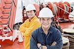 Portrait of workers on oil tanker