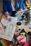 Overhead view of woman in design studio using digital tablet