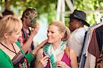 Women trying on scarf in market