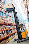 Warehouse worker using forklift