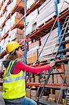 Worker walking up on ladder