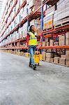 Happy woman pushing warehouse floor
