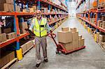 Warehouse worker pulling a warehouse isle