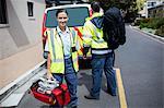 Ambulance men carrying care facilities