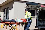 Ambulance men taking care of injured people