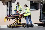 Ambulance men carrying injured people on stretcher
