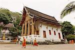 Monks outside buddhist temple, Luang Prabang, Laos