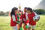 Girls soccer team celebrating