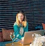 Sweden, Sodermanland, Nacka, Sickla, Mid-adult woman surfing net at cafe