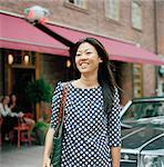 Sweden, Stockholm, Ostermalm, Eriksbergsgatan, Mid-adult woman smiling