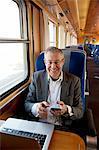 Sweden, Portrait of businessman on train