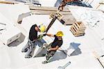 Sweden, Ostergotland, Linkoping, Construction workers adjusting blocks on construction site