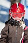 Norway, Osterdalen, Trysil, Portrait of smiling girl (4-5) standing on ski slope
