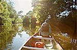 Sweden, Vastergotland, Lerum, Savean, Boy (12-13) in baseball cap sitting in canoe