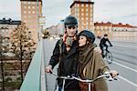 Sweden, Uppland, Stockholm, Vasatan, Sankt Eriksgatan, Young couple with bicycles on street