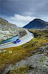 Norway, More og Romsdal, Sunnmore, Geirangerfjord, Blue car driving along winding section of Trollstigen road