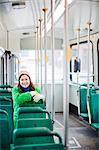 Finland, Helsinki, Young woman sitting in tram