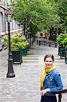 France, Ile-de-France, Paris, Portrait of young woman wearing denim jacket