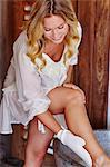 Beautiful woman exfoliating legs.