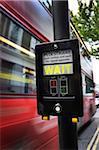 View of Speeding Bus at Crosswalk, London, England, UK
