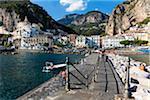 Walkway promenade along shoreline of harbor in the town of Amalfi, Amalfi Coast, Italy