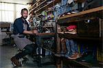 Portrait of male cobbler in traditional shoe workshop