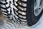 Car tire at winter, close-up