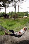 Sweden, Bohuslan, Woman relaxing in hammock