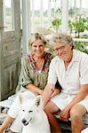 Sweden, Gotland, Bursvik, Burgegard, Portrait of smiling senior couple