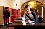 Sweden, Stockholm, Ostermalm, Male student reading at desk