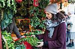 Sweden, Stockholm, Gamla Stan, Woman choosing christmas wreath at market