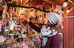 Sweden, Stockholm, Gamla Stan, Woman choosing candy at market