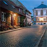 Sweden, Skane, Lund, Idyllic street at autumn night