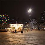 Sweden, Skane, Malmo, Stortorget, Illuminated carousel in town square
