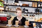 Sweden, Bartender at bar counter making coffee drinks