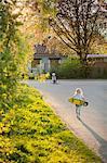 Sweden, Vastergotland, Lerum, Girl (6-7) walking to boy (8-9) with skateboard
