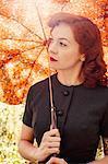 Sweden, Redheaded woman holding umbrella