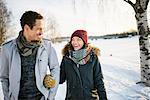 Sweden, Vasterbotten, Umea, Young couple walking in winter