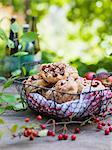 Sweden, Sweet apple and hazelnut buns in metal basket on wooden table