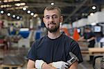 Portrait confident worker in steel factory