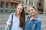 Sweden, Vastra Gotaland, Gothenburg, Portrait of two smiling girls (14-15)