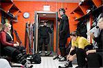 Sweden, Female hockey players getting ready in locker room