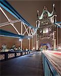 UK, England, London, Pedestrian walkway of Tower Bridge at night