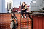 Sweden, Vasterbotten, Umea, Two young women using phones