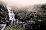 Norway, Vastlandet, More og Romsdal, Trollstigen, Bridge next to waterfall