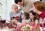 Smiling family at Christmas dinner