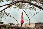Finland, Varsinais-Suomi, Young woman looking at ocean