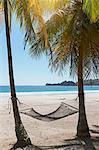 Hammock tied to tree trunk at beach, Samara, Costa Rica